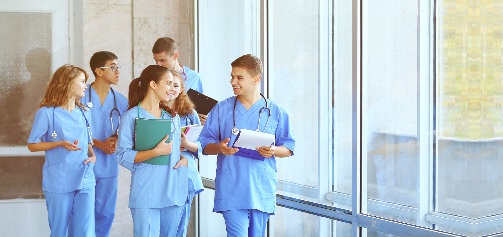 nurses walking and smiling together