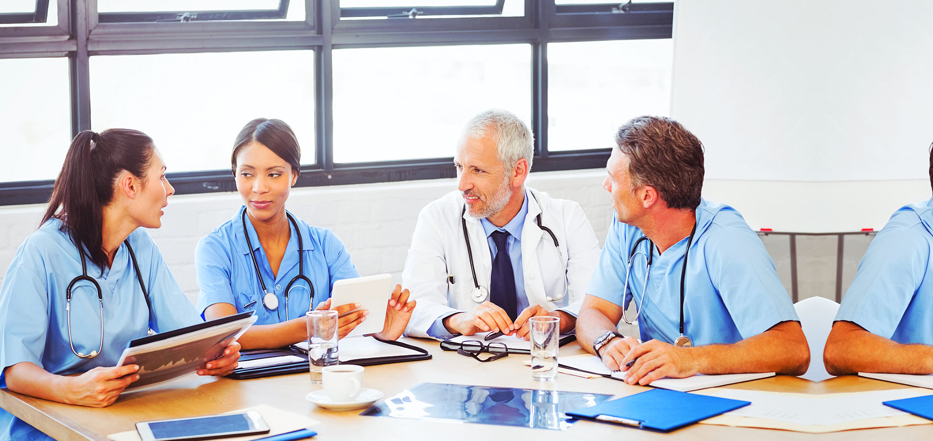 nurses and a doctor having a meeting
