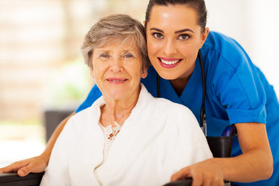 female nurse and senior woman smiling
